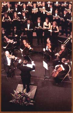 Image of the choir and orchestra from the Mozart Requiem performance.